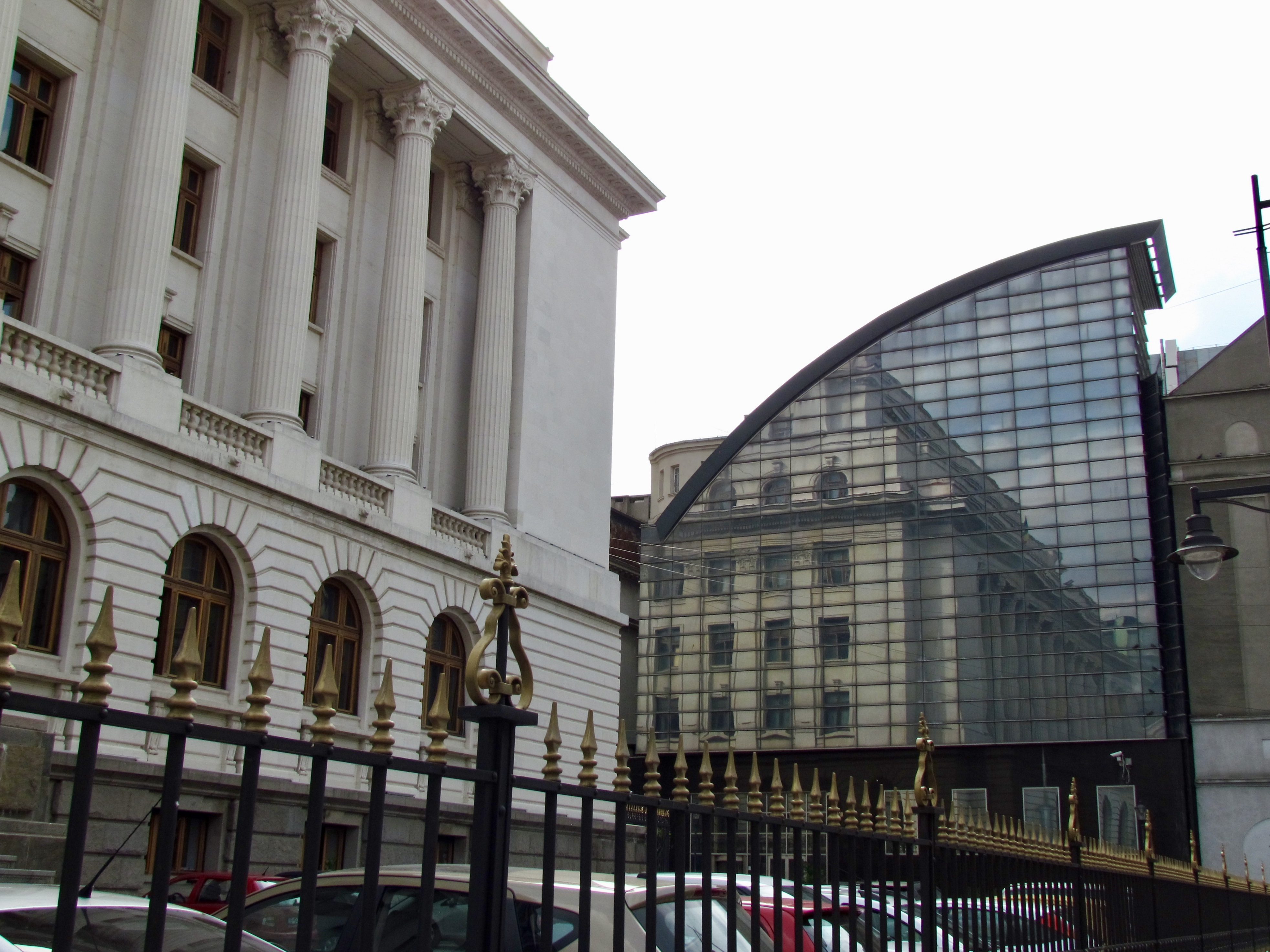 Reflection of the National Bank of Romania Museum in a modern buidling